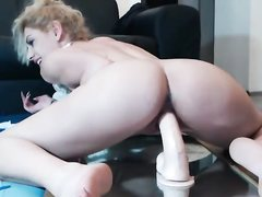 Natasha sucks and rides huge dildo on camera