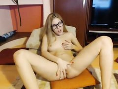 Cute blonde teen in glasses loves masturbation